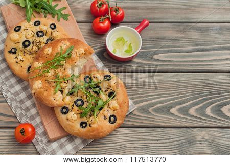 Delicious italian focaccia on wooden background