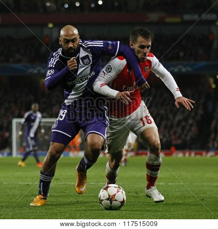 LONDON, ENGLAND - NOV 04 2014: Arsenal's Hector Bellerin and Arsenal's Aaron Ramsey  during the UEFA Champions League match between Arsenal from England and Anderlecht from Belgium
