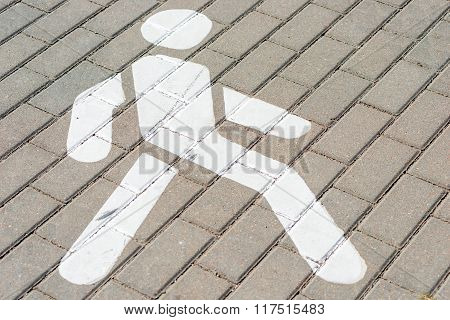 Man Sign White Color On The Sidewalk