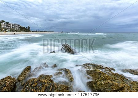 Ocean current rushing against a large rock at Elephant Rock Gold Coast