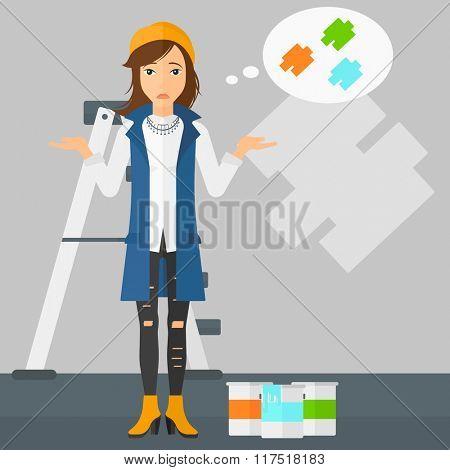 Woman choosing paint color.