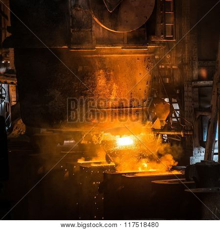 Tank pours the liquid steel in the forms