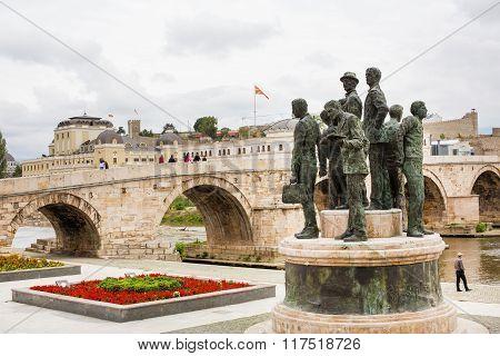 Statue, Macedonian flag and bridge in downtown of Skopje