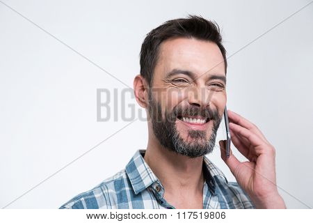 Happy man talking on the phone isolated on a white background
