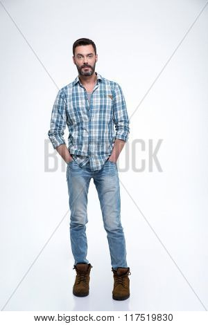 Handsome casual man standing isolated on a white background and looking at camera