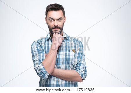 Handsome serious man looking at camera isolated on a white background
