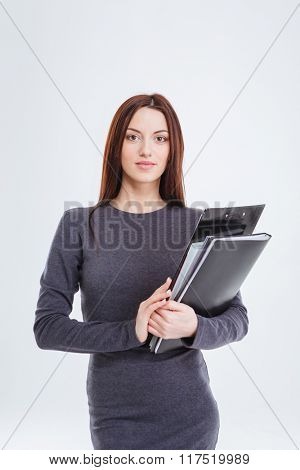 Young businesswoman holding folders isolated on a white background