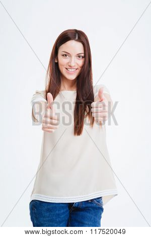 Happy woman showing thumbs up isolated on a white background