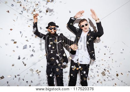Two young men dancing on party