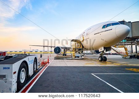 DUBAI, UAE - MARCH 30, 2015: Boeing 777 docked in Dubai airport. Dubai International Airport is a major airline hub in the Middle East, and is the main airport of Dubai.
