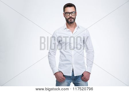 Mature businessman standing isolated on a white background and looking at camera