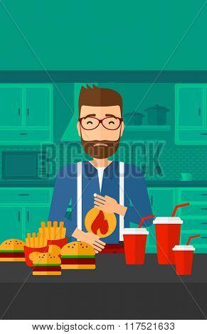 Man suffering from heartburn.