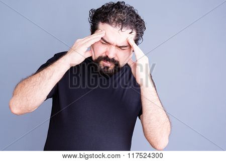 Overworked Man Rubbing His Forehead
