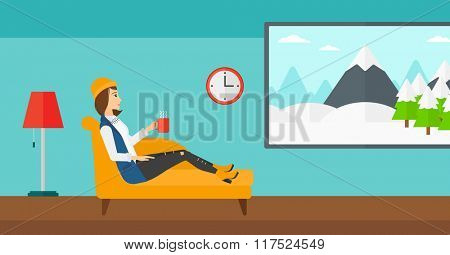 Woman lying with cup of tea.