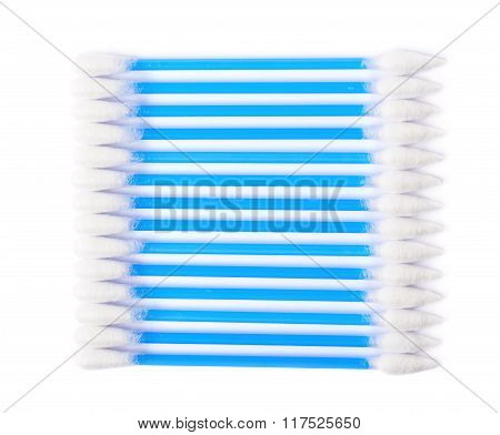 Row of multiple cotton swabs isolated