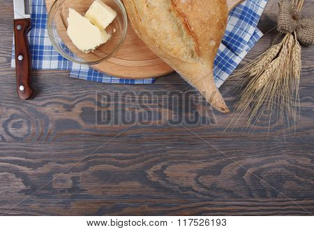Food background top view with wheaten baked bread and butter