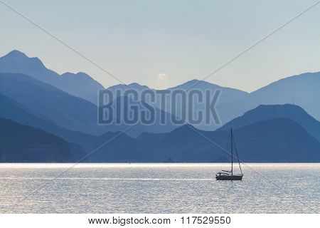 Sea, Mountains And A Fisherman Boat.