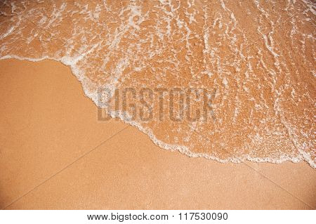 Sea Wave On The Yellow Sand On The Beach
