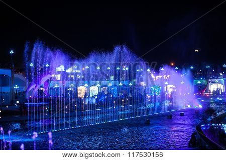 Night Fountain In The City With Modern Illuminated