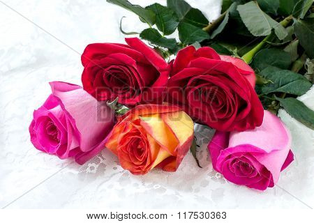 Bouquet Of Multicolored Roses In A Gift