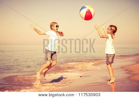 Two Sisters Playing On The Beach At The Day Time.