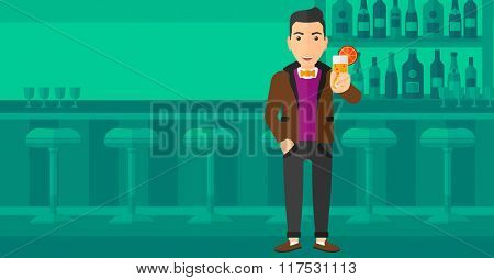 Man holding glass of juice.