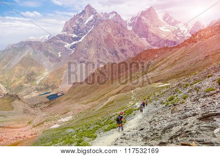 White Asian mountain footpath and group of hikers