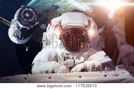 Astronaut in outer space against the backdrop of the planet earth. Elements of this image furnished