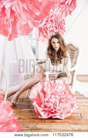 Beautiful Sexy Girl With Huge Pink Flowers Sitting By The Window