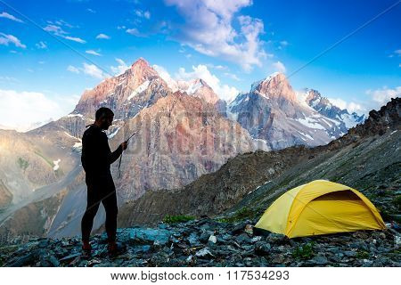 Explorer talking on satellite phone