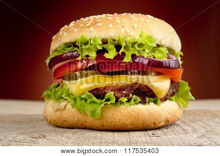 Big Cheeseburger Isolated On Red Background