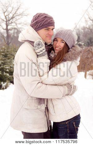 Happy Couple In Park In Winter