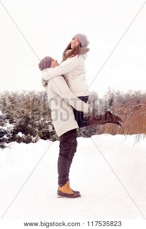 Happy Couple In Park In Winter