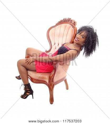 African American Woman In Armchair.