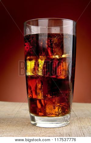 Closeup View Drink Glass Of Cola On Red Spotlight