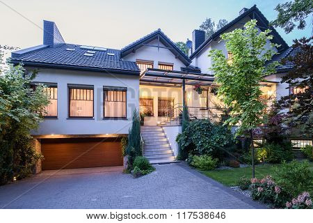 Big Detached House With Lights On