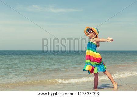 Little Girl  Standing On The Beach
