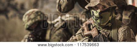 Soldiers In Battle Dress Uniform