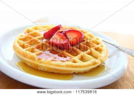 Waffle with strawberries and copy space