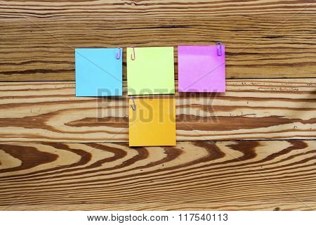 Sticker Notes On The Wooden Background