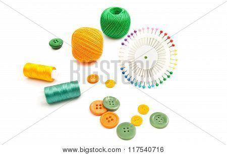 Colored Pins, Threads And Buttons On White
