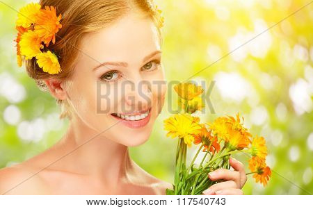 Beauty Face Of  Woman With Orange Yellow Flowers