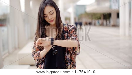 Young woman checking her wristwatch