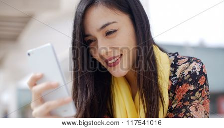 Young woman reading a message on mobile
