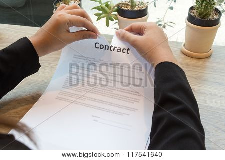 Businesswoman Ripping Up A Contract