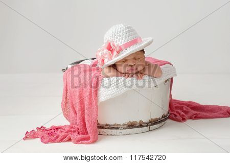 Newborn Baby Girl Wearing An Easter Hat