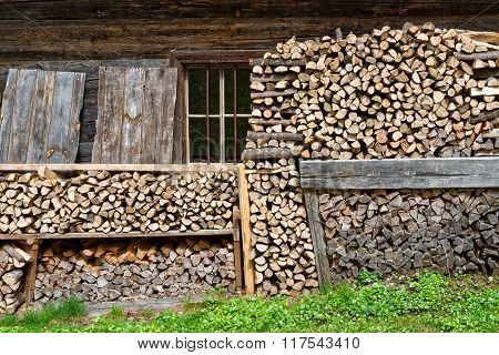Firewood stacked in a alpine hut