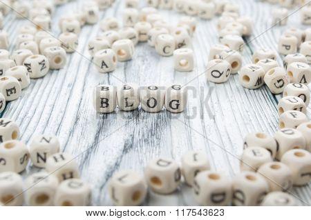 Blog word written on wood block. Wooden ABC