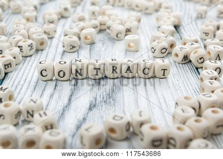 contract word written on wood block. wooden abc.