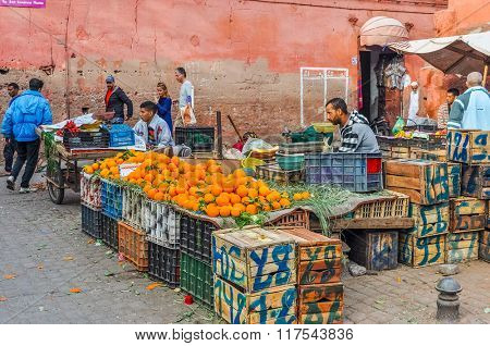 MARRAKESH, MOROCCO, APRIL 3, 2015:  Local sellers offer oranges and other fruits on street stands in souks